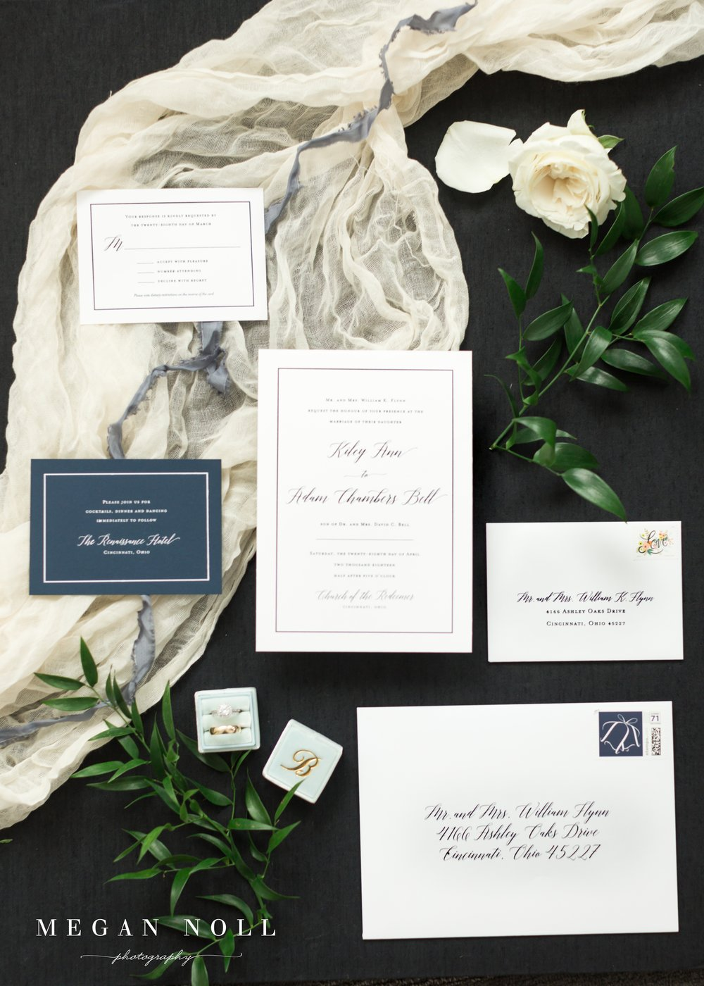 Wedding suite with navy thermography and white foil with bell motif. Photo by Megan Noll Photography