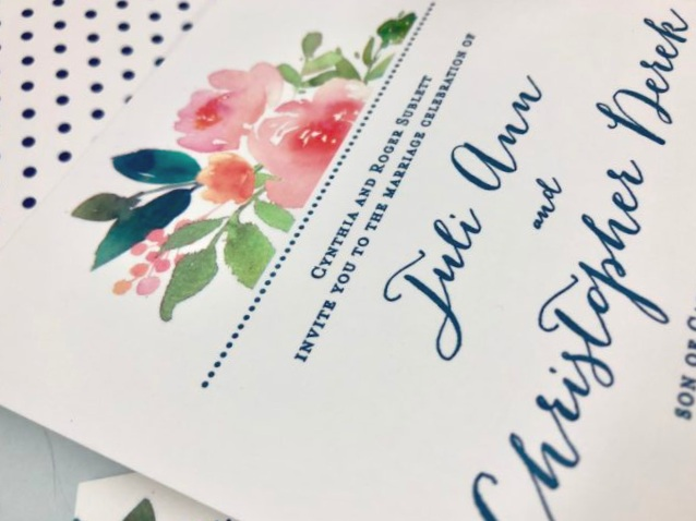 Coordinating watercolor floral wedding invitation with polka dot envelope liner