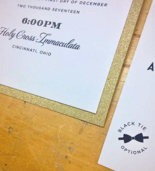 Black and gold wedding invitation detail