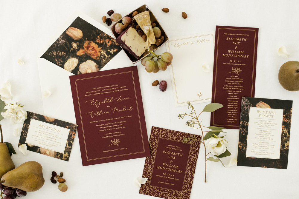 Burgundy and gold letterpress wedding suite with painted floral lined envelope by Bella Figura.  Photographer    Carina Skrobecki    and stylist    Cozbi Jean