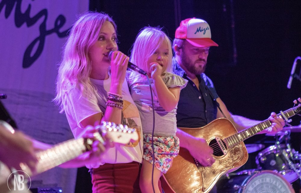 Jill Martin often performs with her husband, musician Logan Mize, and even sometimes her little ones. This is Jill and Logan with miss Violet.