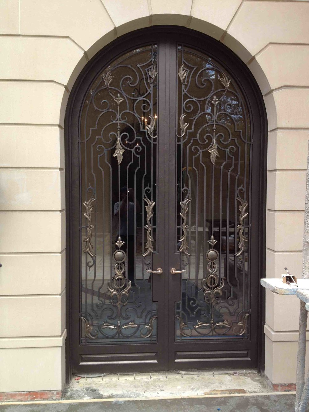 Hand Forged Wrought Iron Doors with Steel Scrolls and Bronze Handles