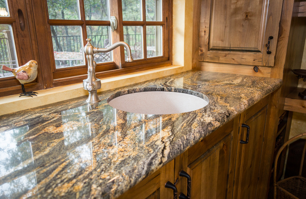 Granite countertop and Travertine floor