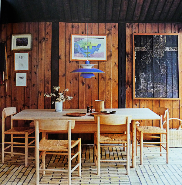 Borge Mogensen furnished his dining room with his Shaker-inspired chairs and table. Fellow Danish designer Poul Henningsen designed the chandelier.