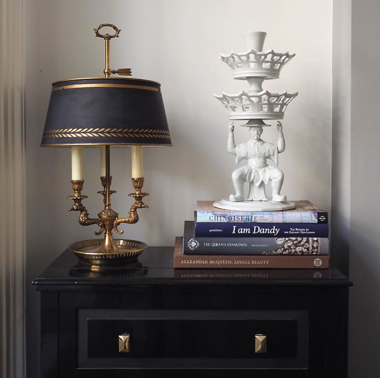 A bouillotte lamp with a blanc de chine figurine.
