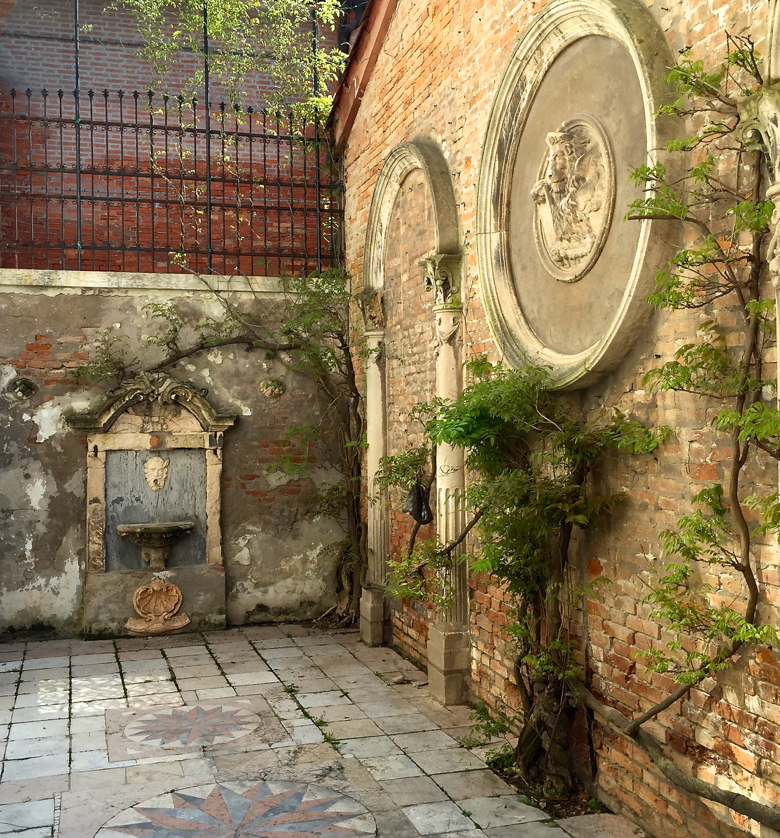 A small courtyard in the garden at Fortuny in Venice