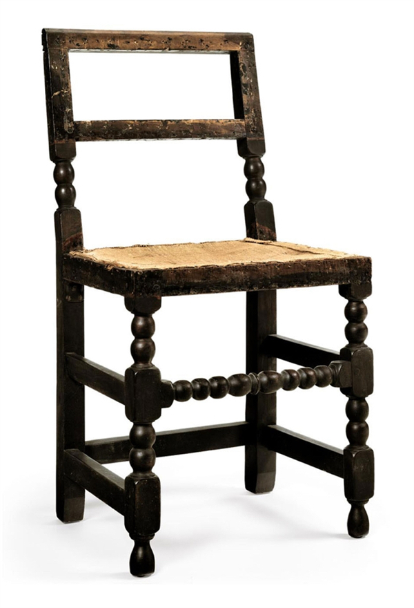 A Cromwellian side chair, maple, late 17th century from Boston.