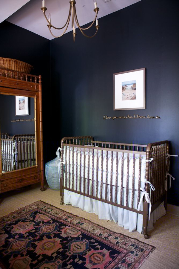 Nursery with a bronze spool crib by Le Sueur Interiors. Fabulous near black walls –a risk in a child's room that really paid off.