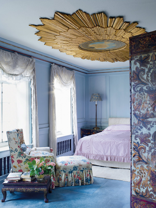 A Baroque frame on the ceiling of a bedroom in Victoria Press's London townhouse, with a contemporary painting in the Baroque style by Wally Carvell in the center.