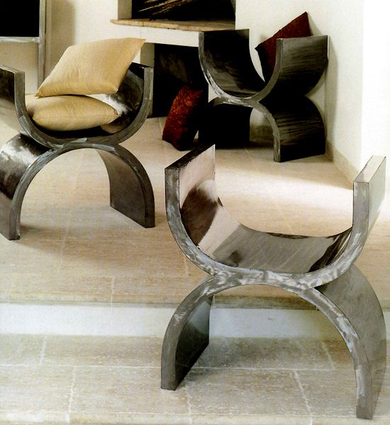 A chic iron and lacquered contemporary version of the curule stool