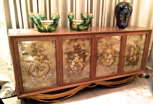 3. What is the name of the decoration on the doors of this lovely cabinet?