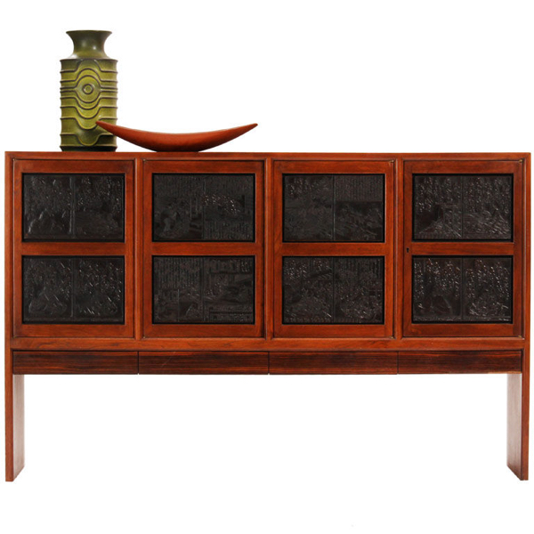 """A slab-sided, walnut """"Janus"""" cabinet with four doors – set with antique Japanese printing plates – over four rosewood-front drawers."""