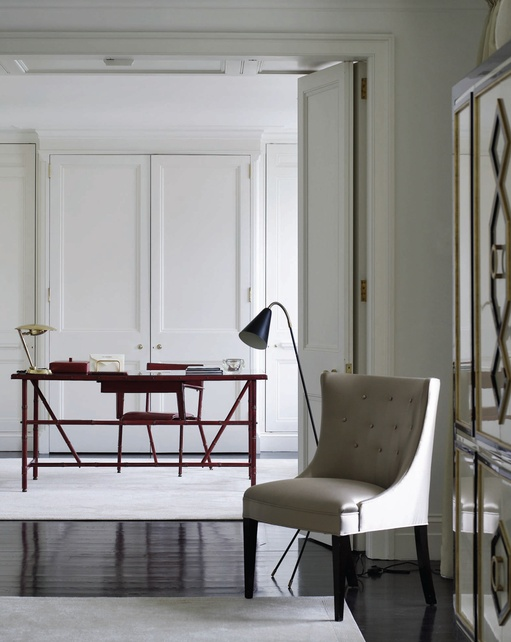 Red leather desk and chair by Jacques Adnet in the home of London Designers' Carole Katleman and Daniel Cuevas.