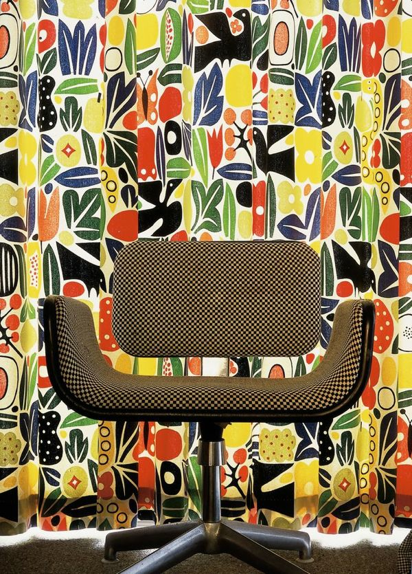 "Alexander Girard chair in front of Alexander Girard fabric. Furniture designed by Girard is relatively rare. Photo by Eric Laignel via Interior Design   "" I am a reasonable and sane functionalist tempered by irrational frivolity."" Alexander Girard"