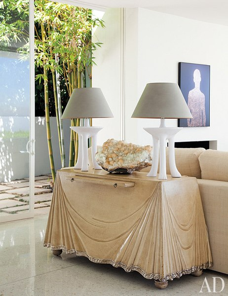 John Dickinson lamps atop an Aldo Tura console. Beverly Hills home of architect and designer Daniel Romualdez.
