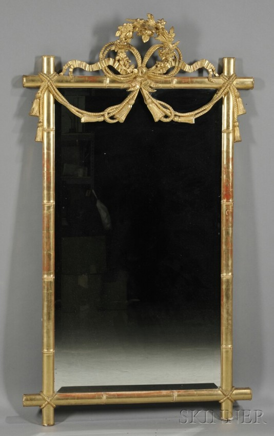 Giltwood Faux Bamboo Mirror, 19th century, with floral wreath cresting, bows of ribband, and tasseled roping over rectangular beveled mirror with faux bamboo frame