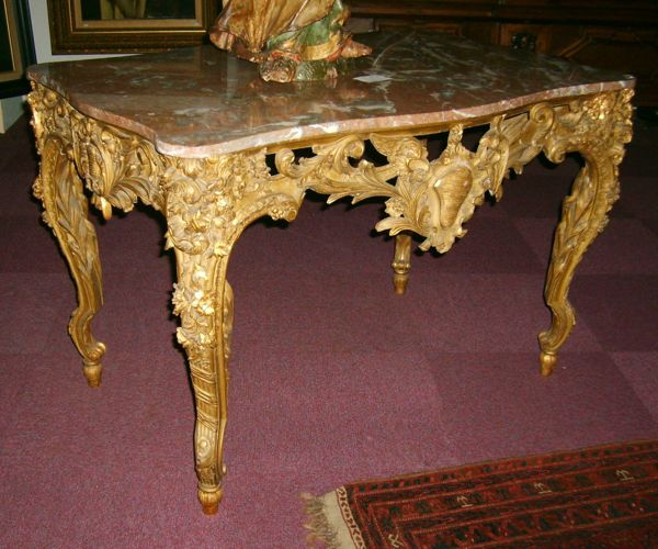 Rococo table, c.1750, Note the irregular pebble shape in center (rocaille).