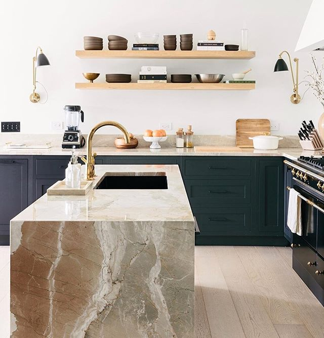Marble kitchen island in the Anna Bond's home, CEO of Rifle Paper Co.