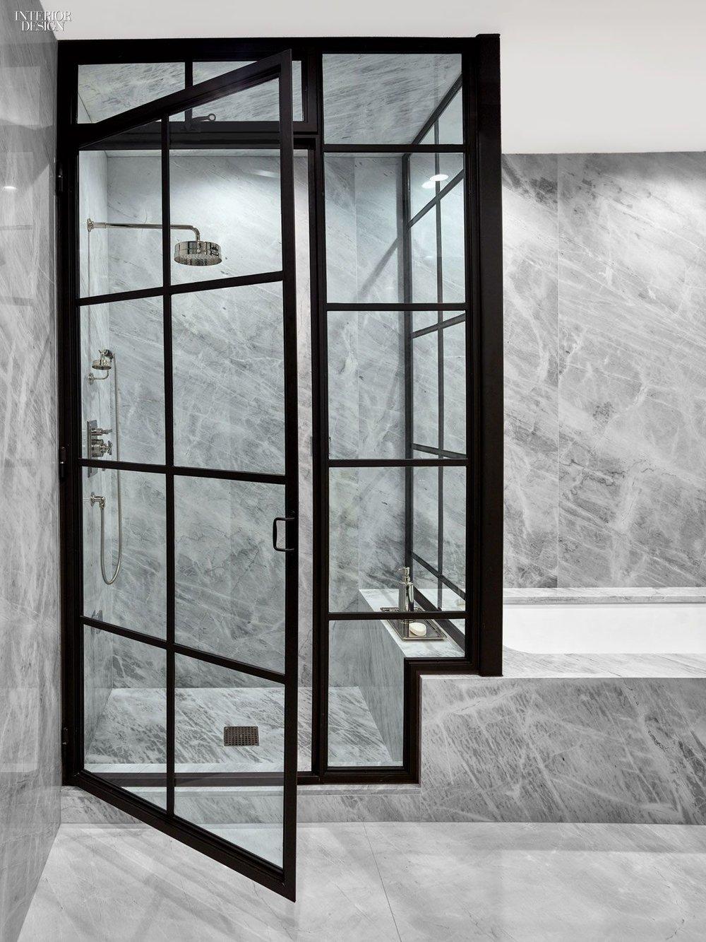Steel shower door, marble slab bathro