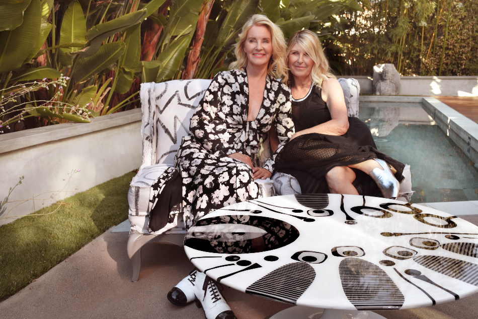 Photo: Lise Abraham (left) and Suzanne Currie (right) on the Fray twin chairs and pop art round table.