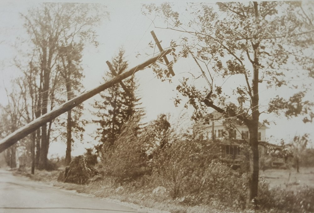 Damage in the Lakes Region was limited to property and utilities. This electric pole across from what is now Kingswood Regional High School in Wolfeboro was damaged when a large maple tree fell. Courtesy Wolfeboro Historical Society