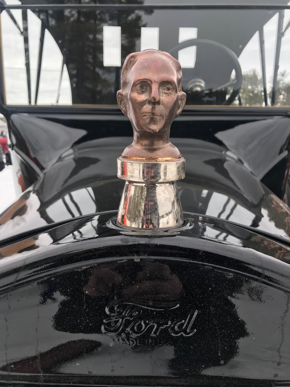 A Henry Ford hood ornament on a Model-T snowmobile that was recently on display on Milton Three Ponds. The snowmobile was in West Ossipee. The rally took place as part of town's annual winter carnival.