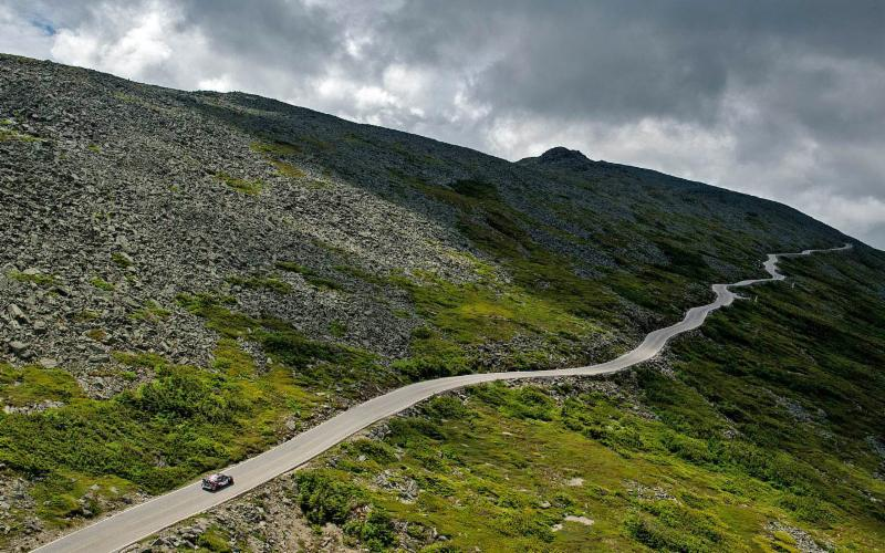 """Mt. Road - Travis Pastrana negotiates the serpentine """"6-Mile"""" section of the Mt. Washington Auto Road, where the edge of the asphalt drops away into the steep ravine of the Great Gulf. (Courtesy photo)"""