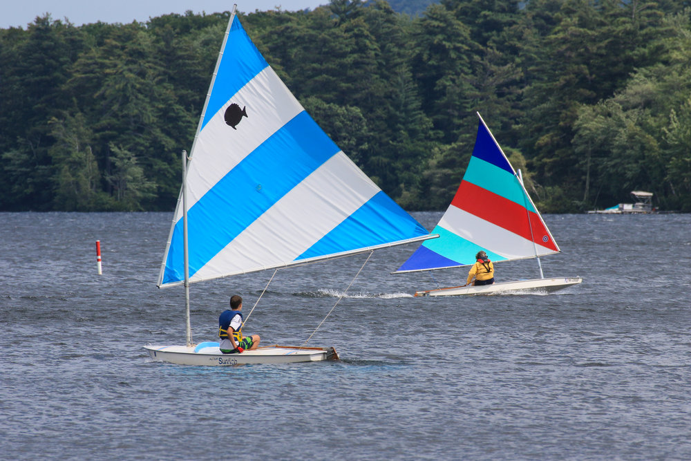 Colorful sails are displayed at the NH Boat Museum's regatta