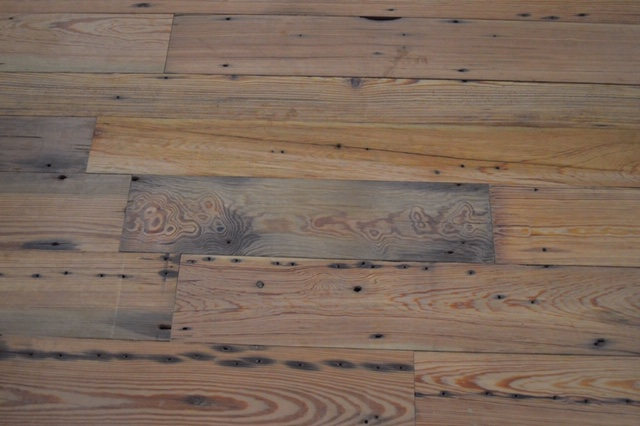 A portion of the floor crafted fro reclaimed wood