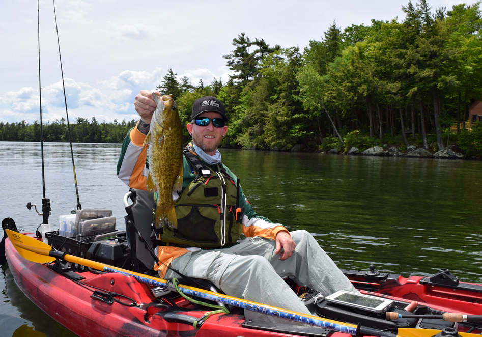 Tim Moore, owner and guide at Tim Moore Outdoors during Kayak University on Squam Lake.  Photo Courtesy of Stack 9 Photography