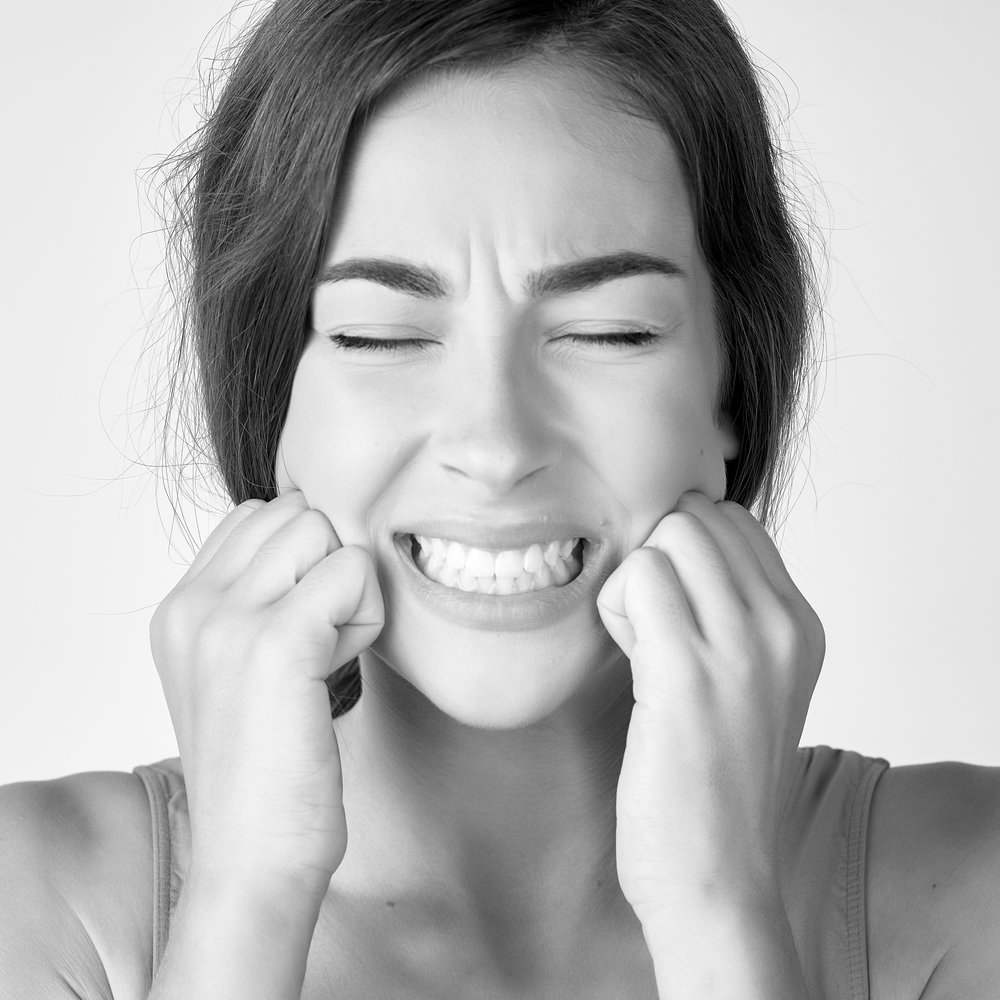 Woman with Tooth Pain Holding her Face
