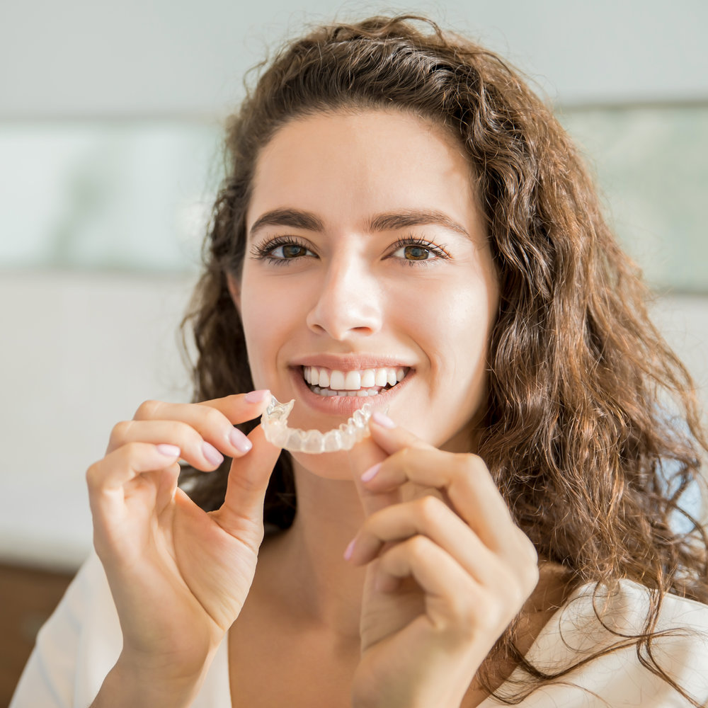 Woman with Invisalign Clear Aligners Smiling