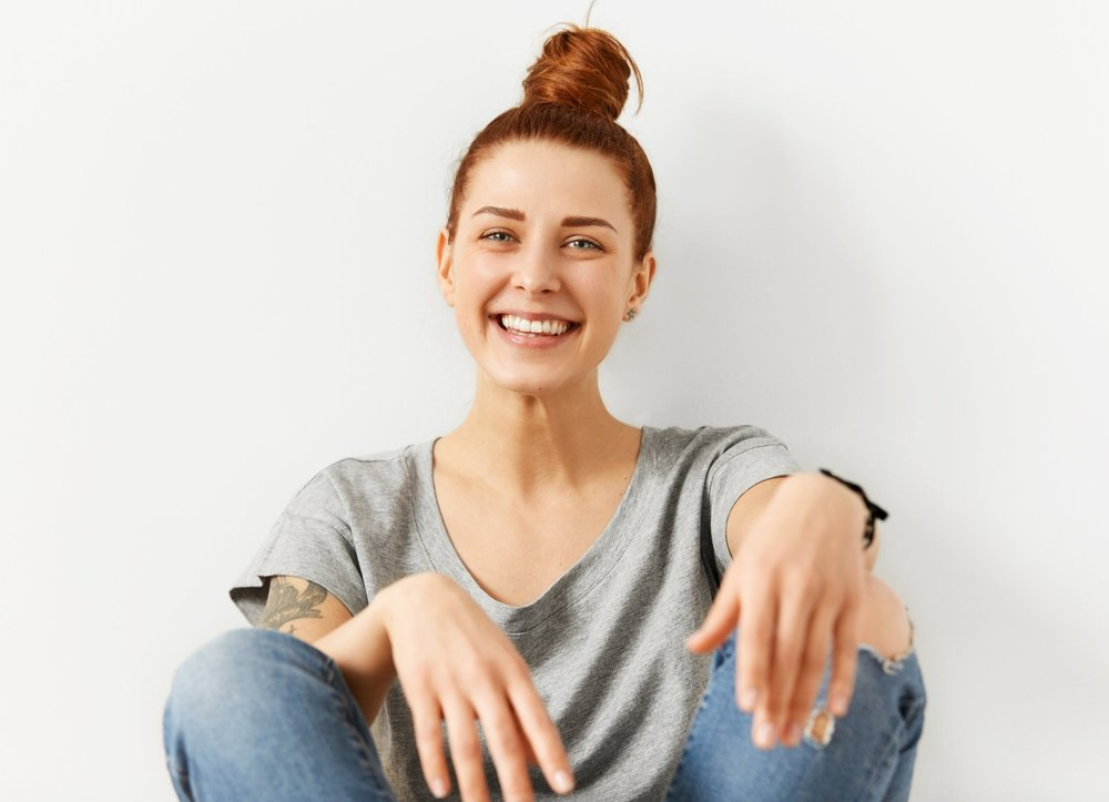 Hipster Woman Smiling with Nice Teeth after her cleaning at Total Health Dental Care.