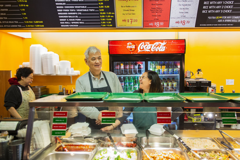 My dad, Mikey and sister Kathryn, share a moment behind the counter at Mikey's Eatery in Waterloo.