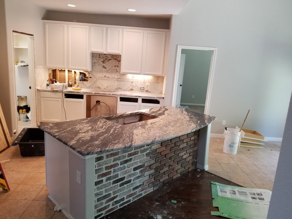 Interior Services - When you need top-notch interior services in Houston, such as flooring, cabinet installation, painting, or drywall repair, give us a call!