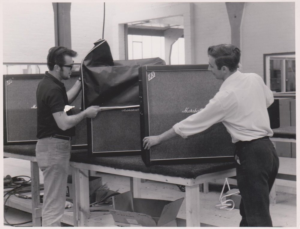 Ken Bran and Les Mathews going over cabinets, 1967.  photo courtesy of Marshall Amps