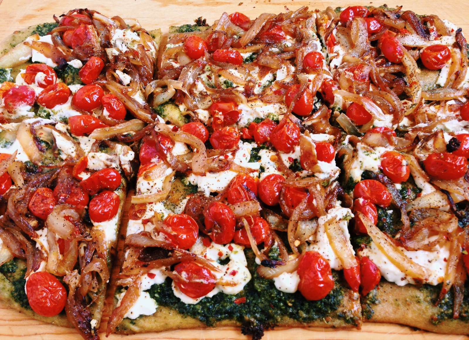 Goat Cheese Pizza with Caramelized Onions and Pesto