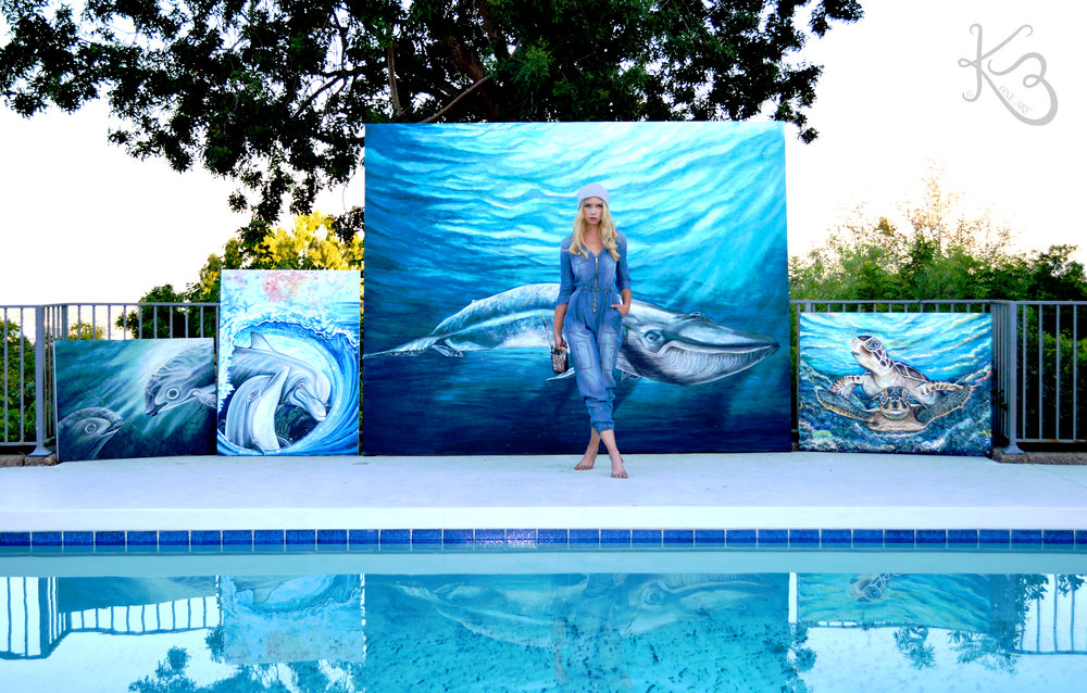By the pool with her paintings and brush bucket