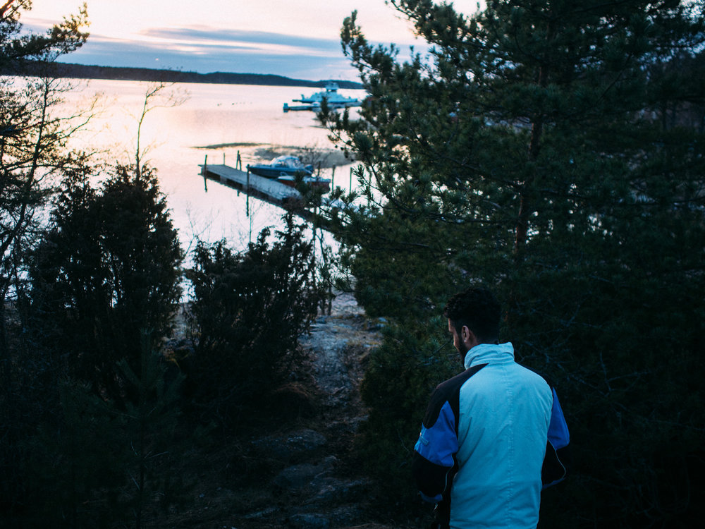 """Velkua is the new home of Ihab and Yousef, a quiet and peaceful village of around 200 people, immerse in the Finnish nature. Water and forests are all around. It's one of those places where people go to """"recharge their batteries"""" after a year of working."""