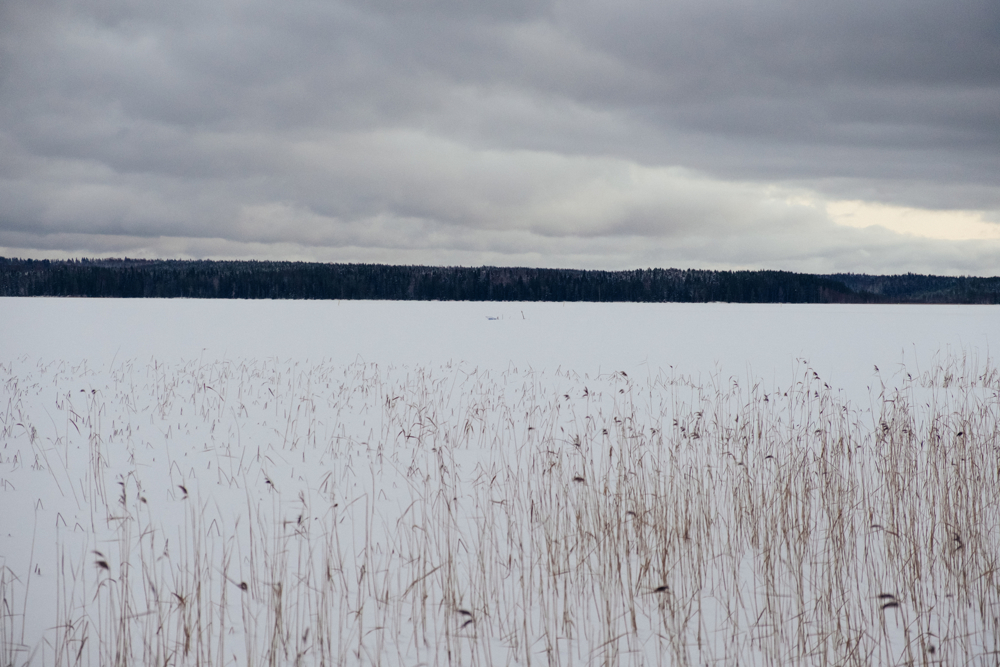 A frozen lake.The border line passes exactly in the middle of it, marked by a white and a black buoy. on the other side Russia. In 2015 a group of three Syrian asylum seekers coming from Russia illegally entered Finland crossing the lake during the first months of the years.