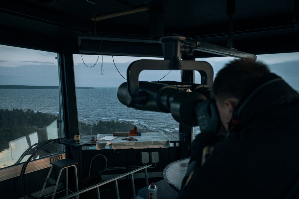 Watching towers are deployed on many island along the border. Janne a 31 years old official, checks the Russian coast line looking for Russian boats or inland activity.