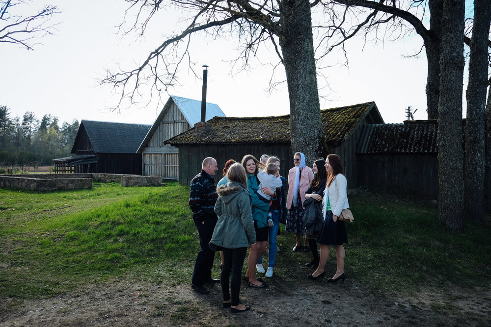 Liepas village, Jekabpils province. On a Sunday afternoon, family members gather together after the mass. Girls say they'll move to bigger cities to study but they don't want to leave the country.