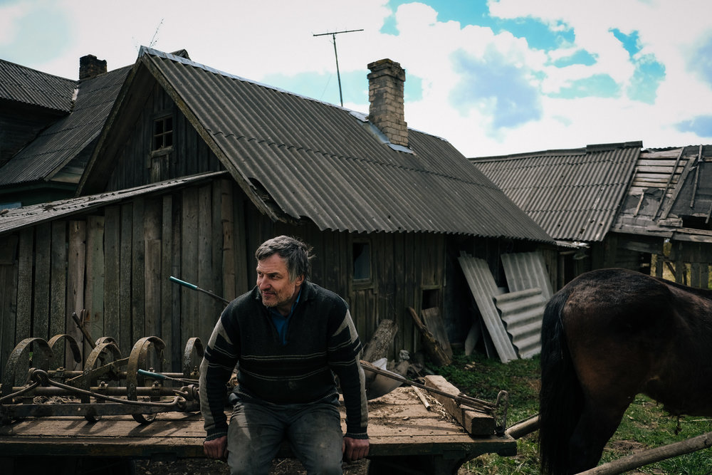Skrudaliena - Latgale. Dimitrij,46, sits on his barrow waiting for a friend. The last data about the village show 186 inhabitants in 2009. Recently few more have left and some old one died.