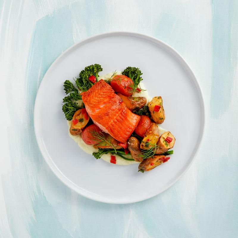 Roasted Salmon  Wild Alaskan salmon, fennel, fingerling potatoes, broccolini, confit tomatoes, piquillo gremolata.