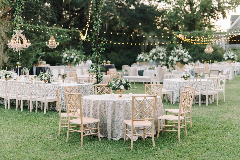They pulled the rich colors of dusty blue, hunter green, black and gold throughout the ceremony and reception spaces. Wedding planning and design by A Charleston Bride