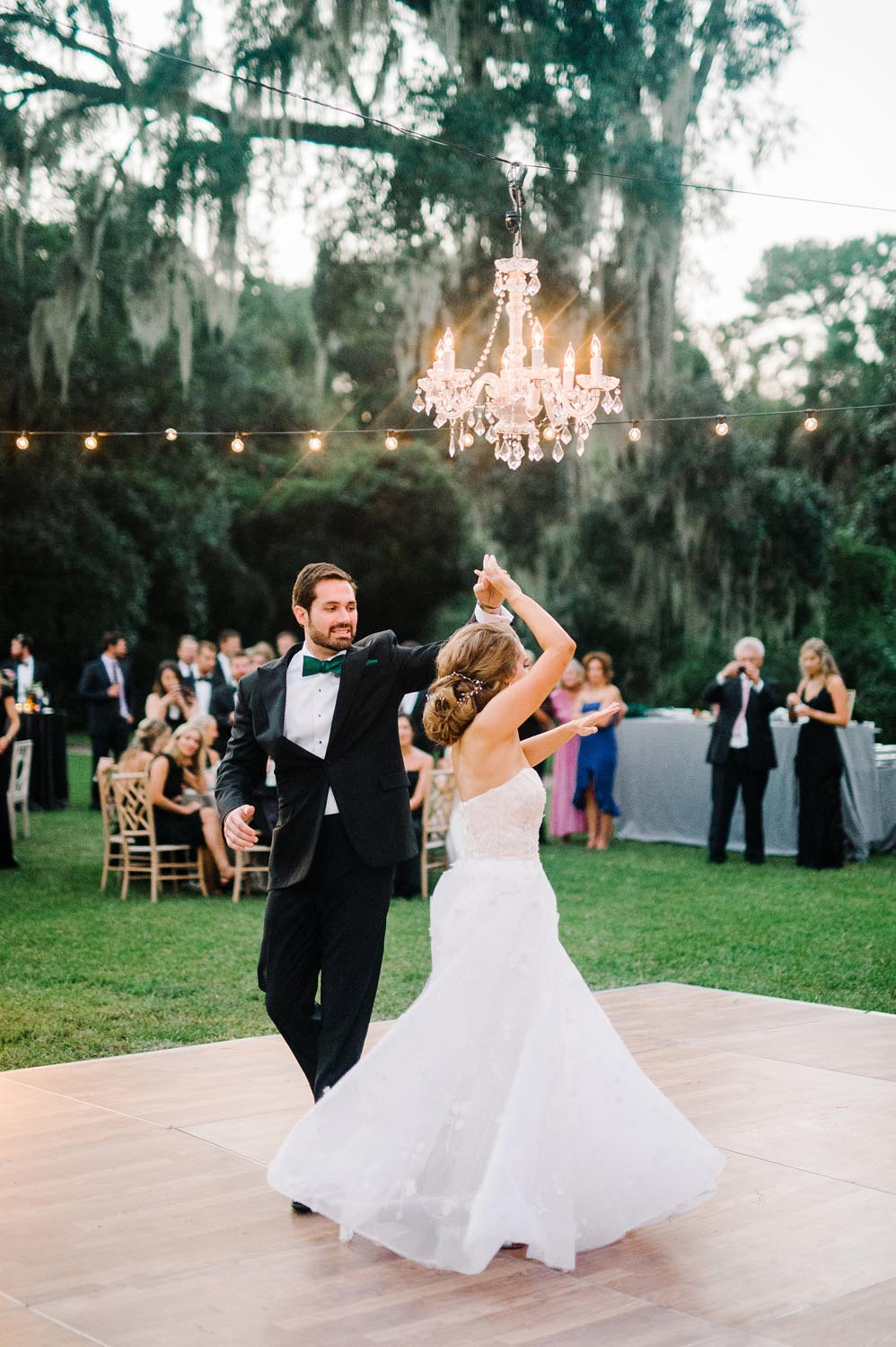 Copy of The garden's natural beauty overflowed with greenery and oaks dripping in Spanish moss. Wedding planning and design by A Charleston Bride