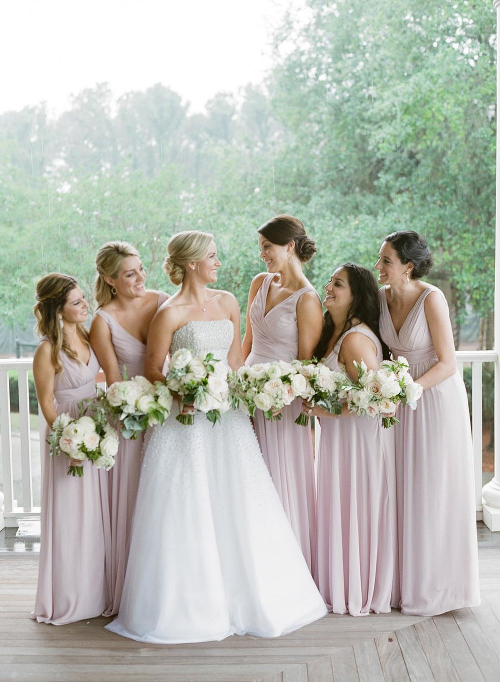 Flowy bridesmaid dresses. Light peach and taupe wedding design. Wedding planning and design by A Charleston Bride.