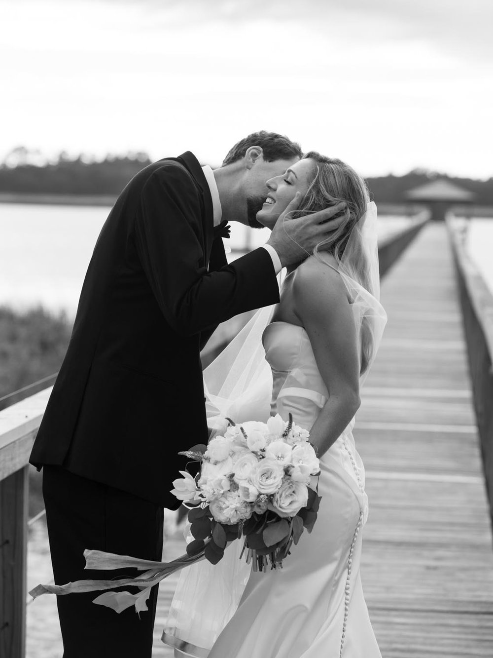Romantic waterfront Charleston wedding. Wedding planning and design by A Charleston Bride.