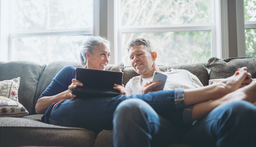 A couple sits together requesting their free estimate online