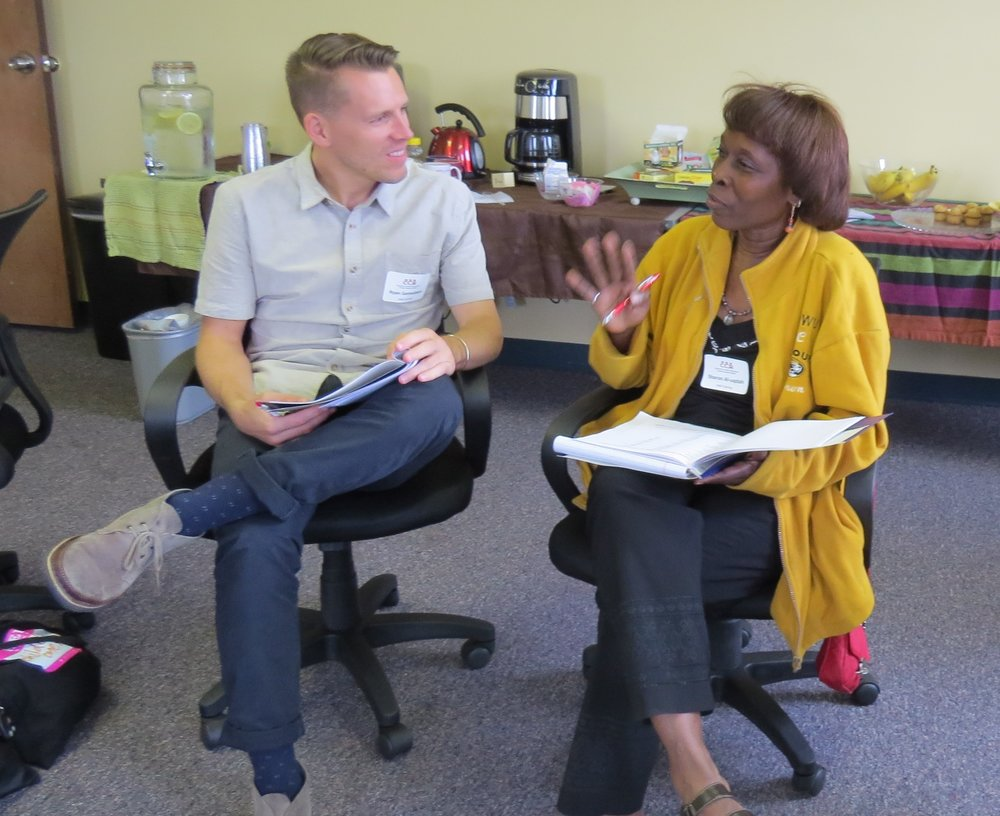 Two participants at an NAB workshop learn how to interact in ways that can de-escalate emotions that can lead to violence and to facilitate agreements between community members, a victim and an offender.